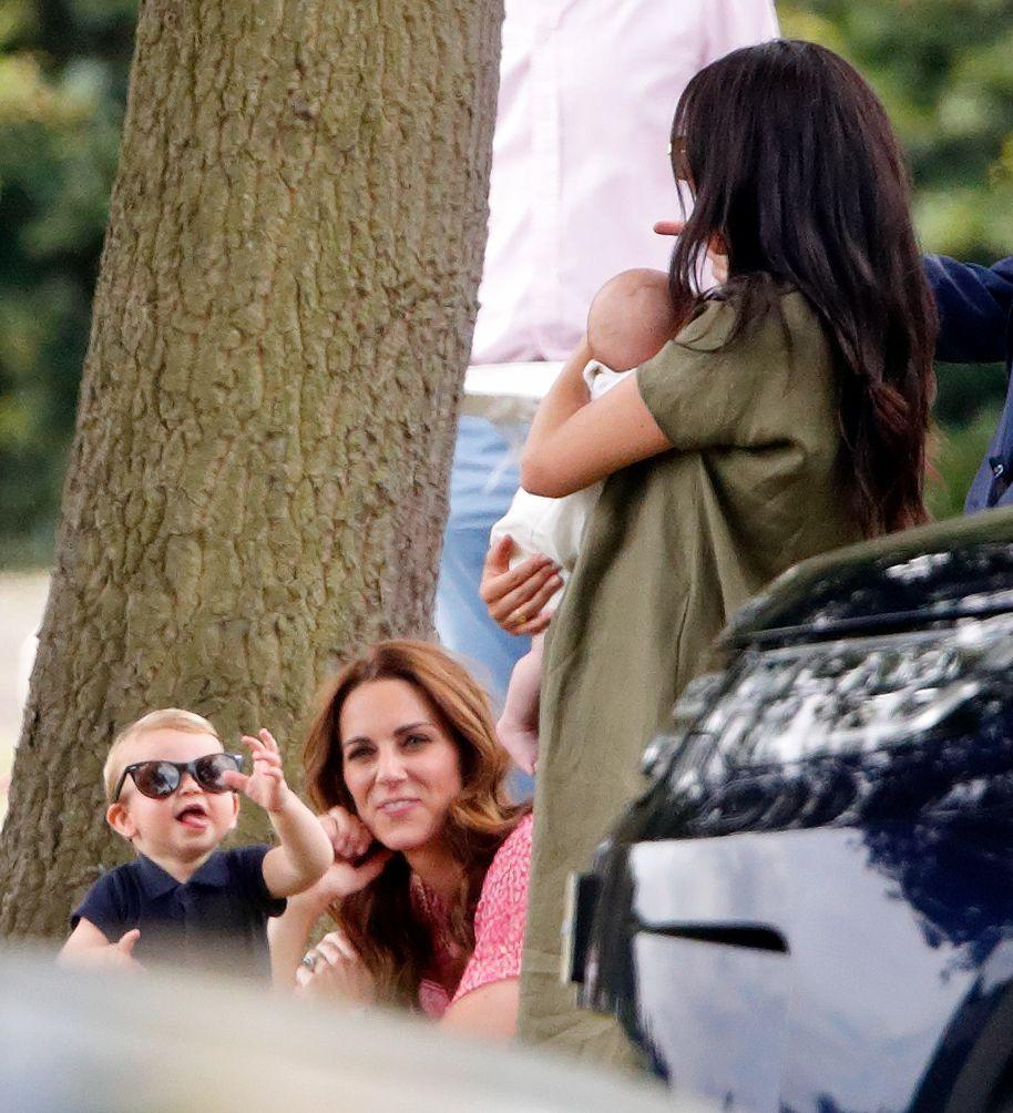 <p>Prince Louis tries on his mom's sunglasses at The King Power Royal Charity Polo Day.</p>