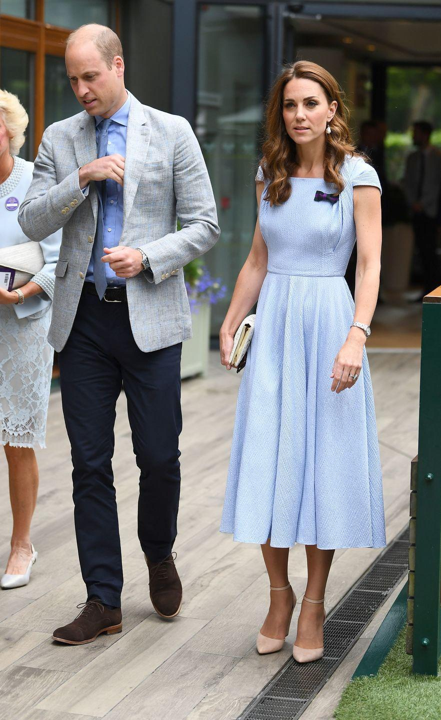 <p>The Duke and Duchess of Cambridge attend the Men's Singles Final with Kate wearing an Emilia Wickstead light blue midi dress paired with Aldo 'Nicholes' heels in Bone.</p>
