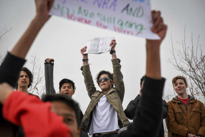 <p>Glenwood Springs High School freshman Johnathon Webster, center, leads his classmates in a chant in a walkout and demonstration during their lunch break in front of the high school in support of the Parkland, Fla., shooting victims and against the NRA, in Glenwood Springs, Colo., Wednesday, Feb. 21, 2018. (Photo: Chelsea Self/Glenwood Springs Post Independent via AP) </p>