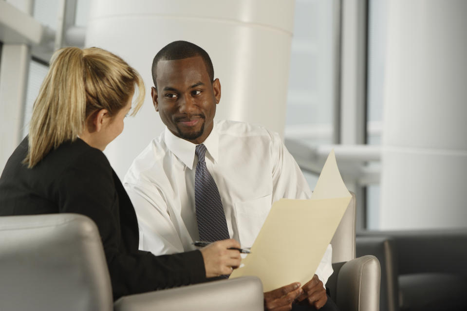 Multi-ethnic businesspeople discussing paperwork