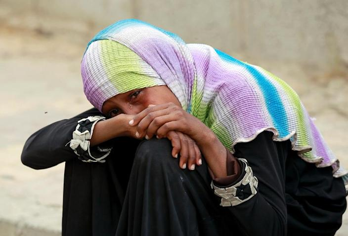 A Yemeni woman cries over the death of relatives in a reported air-strike by the Saudi-led coalition on the capital Sanaa on July 13, 2015 (AFP Photo/Mohammed Huwais)