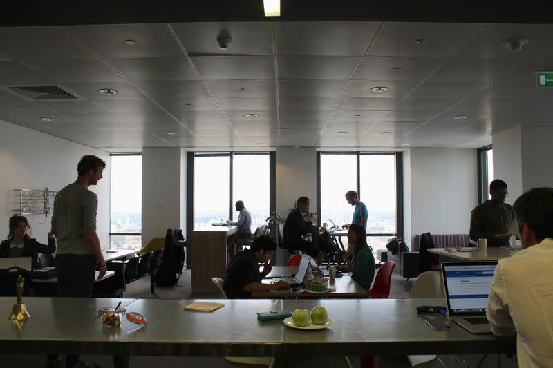 People are seen in the Level39 FinTech hub based in the One Canada Square tower of the Canary Wharf district of London