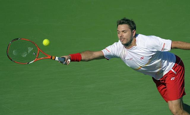 Stanislas Wawrinka, of Switzerland, returns a shot against Kevin Anderson, of South Africa, during a fourth round match at the BNP Paribas Open tennis tournament, Wednesday, March 12, 2014, in Indian Wells, Calif. (AP Photo/Mark J. Terrill)