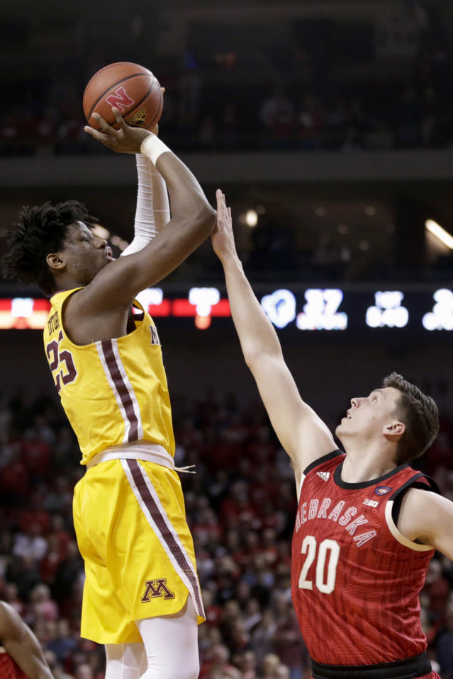 Minnesota's Daniel Oturu (25) shoots over Nebraska's Tanner Borchardt (20) during the first half of an NCAA college basketball game in Lincoln, Neb., Wednesday, Feb. 13, 2019. (AP Photo/Nati Harnik)