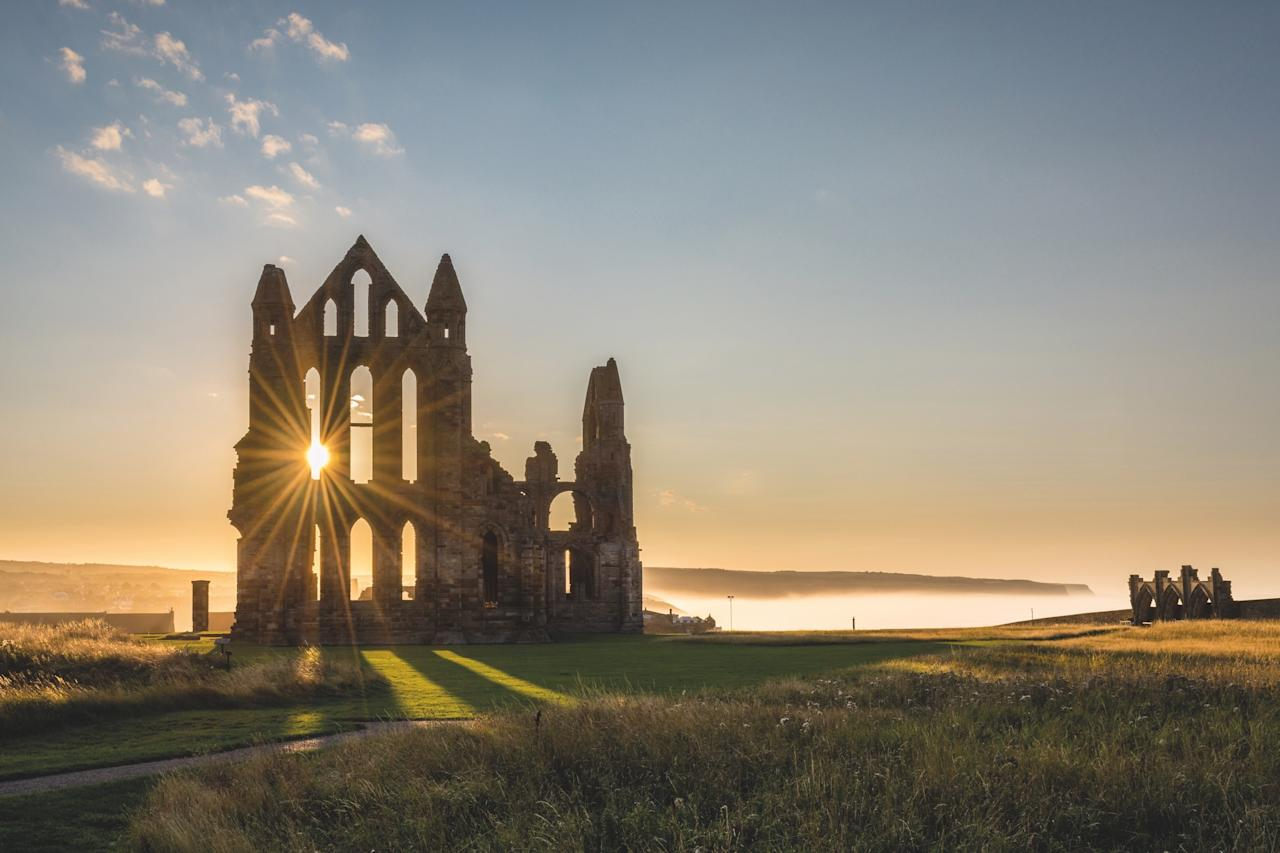 """""""We often assume—wrongly—that sacred sites were abandoned because of one civilization or faith demolishing another,"""" says Joffe. """"Whitby Abbey illustrates a battle <em>within</em> faiths."""" The abbey was suppressed in 1539 when Henry VIII left Catholicsm for Anglicanism. """"Whitby suffered multiple factors of decline,"""" says Joffe. """"Besides monks running out of money, weather damage, and Henry's suppression, there is also the fact that for some reason German warships in World War I fired at the building and those destroyed some of the structure. Ironically the decay of the building and the lack of urban development around it throws into relief the majesty of the Gothic style."""""""