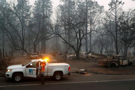 Employees of Pacific Gas & Electric work in the aftermath of the Camp Fire in Paradise