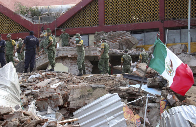 <p>Soldiers remove debris from a partly collapsed municipal building felled by a massive earthquake in Juchitan, Oaxaca state, Mexico, Friday, Sept. 8, 2017. One of the most powerful earthquakes ever to strike Mexico has hit off its southern Pacific coast, killing at least 32 people, toppling houses, government offices and businesses. (AP Photo/Luis Alberto Cruz) </p>