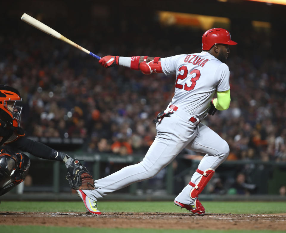 St. Louis Cardinals' Marcell Ozuna starts toward first on an RBI single off San Francisco Giants' Ty Blach during the sixth inning of a baseball game Thursday, July 5, 2018, in San Francisco. (AP Photo/Ben Margot)