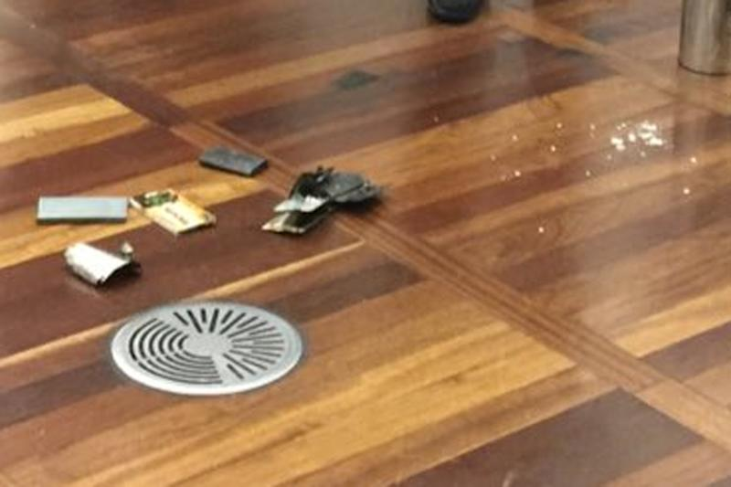 The passenger's phone lies in pieces on the floor at St Pancras (@haxieMB)