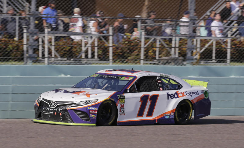 Denny Hamlin drives on the front stretch during a NASCAR Cup Series auto race on Sunday, Nov. 17, 2019, at Homestead-Miami Speedway in Homestead, Fla. Hamlin is one of four drivers running for the championship. (AP Photo/Terry Renna)
