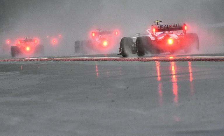 Water way to go: F1 cars behind the safety car in the torrential rain of the Belgian Grand Prix (AFP/JOHN THYS)