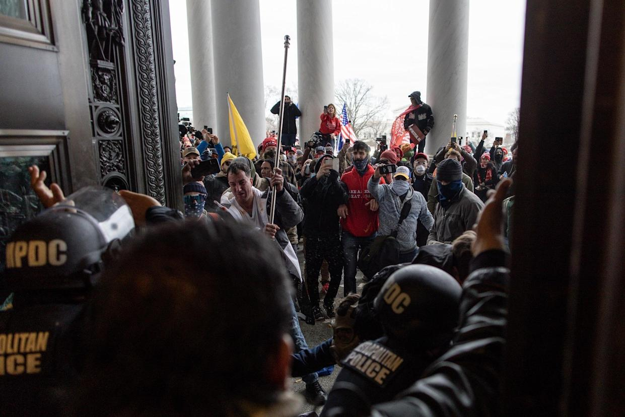 WASHINGTON D.C., USA - JANUARY 6: Police intervenes in US President Donald Trumps supporters who breached security and attempt to enter the Capitol building in Washington D.C., United States on January 06, 2021. Pro-Trump rioters stormed the US Capitol as lawmakers were set to sign off Wednesday on President-elect Joe Biden's electoral victory in what was supposed to be a routine process headed to Inauguration Day. (Photo by Mostafa Bassim/Anadolu Agency via Getty Images)