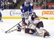 Arizona Coyotes goaltender Adin Hill (31) poke checks the puck from Toronto Maple Leafs right wing William Nylander (88) during the second period of an NHL hockey game, Tuesday, Feb. 11, 2020 in Toronto. (Nathan Denette/The Canadian Press via AP)