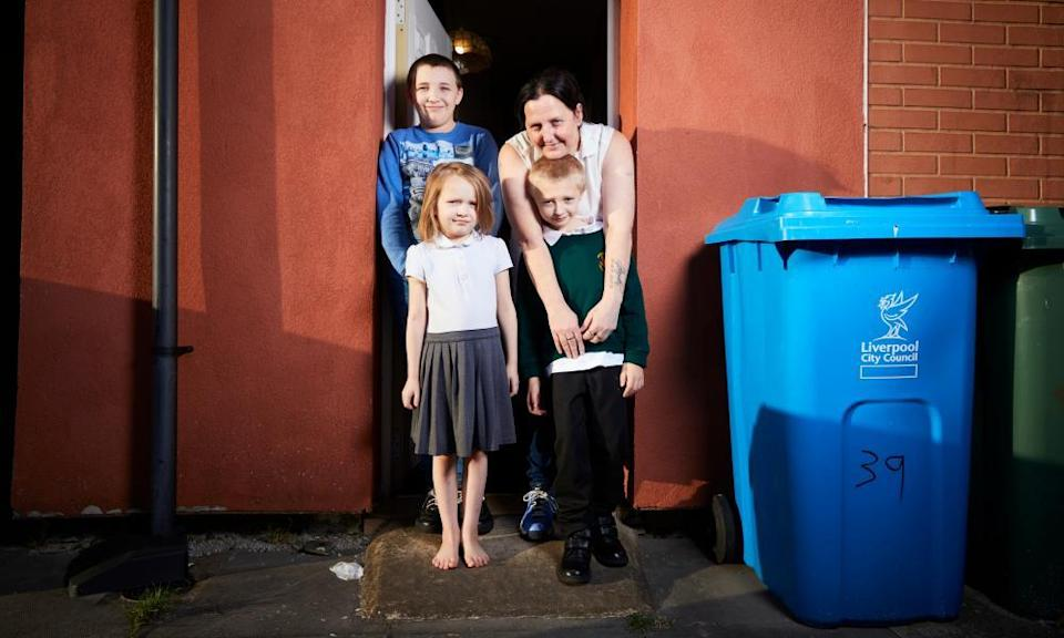 Kim Bills at home with three of her children: Callum, 14, Jordan, eight, and Jayda, seven.