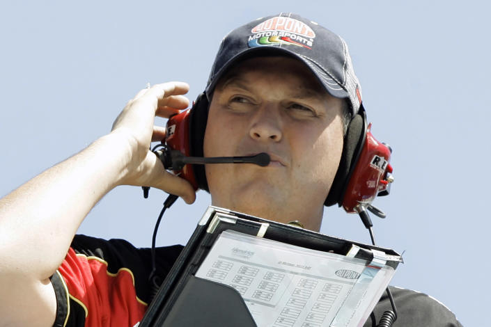 FILE - In this Aug. 17, 2007, file photo, crew chief Steve Letarte watches Jeff Gordon during practice for the NASCAR 3M Performance 400 at Michigan International Speedway in Brooklyn, Mich., in this Friday, Aug. 17, 2007, file photo. NBC analyst Steve Letarte moonlights as the competition consultant for Spire Motorsports, a position he never imagined would put him back on top of a pit box. When COVID-19 protocols sidelined the regular crew chief, Letarte agreed to get back on top of a pit box Sunday, Feb. 28, 2021, at Homestead-Miami Speedway. He'll call the race for Corey LaJoie, his first time as crew chief since the 2014 season finale. (AP Photo/Paul Sancya, File)