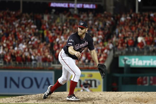 Washington Nationals starting pitcher Stephen Strasburg throws his final pitch during the seventh inning of Game 3 of the baseball National League Championship Series against the St. Louis Cardinals Monday, Oct. 14, 2019, in Washington. (AP Photo/Jeff Roberson)