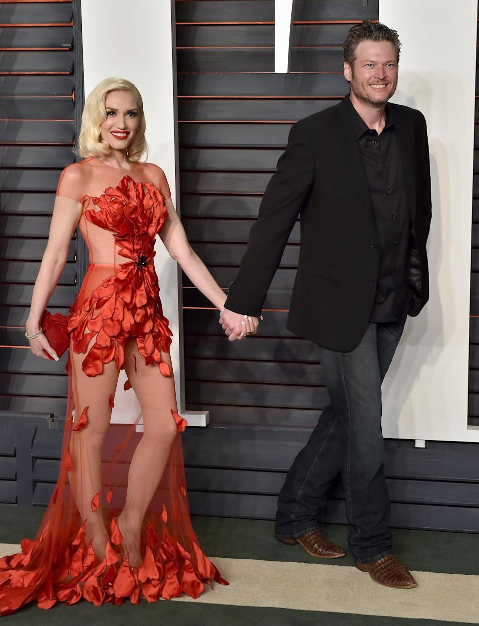 <p>Blake let Gwen steal the spotlight in this Yanina Couture satin petal gown at the 2016 <strong>Vanity Fair</strong> Oscar party. Her Jimmy Choo clutch just brought more attention to the fact that Gwen looks really good in red. </p>