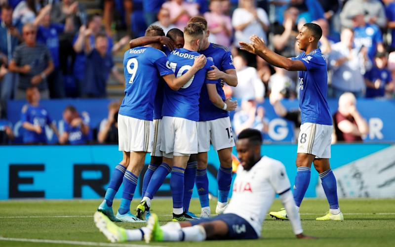 Leicester City's Ricardo Pereira celebrates scoring their first goal with team mates as Tottenham Hotspur's Danny Rose  - Action Images via Reuters