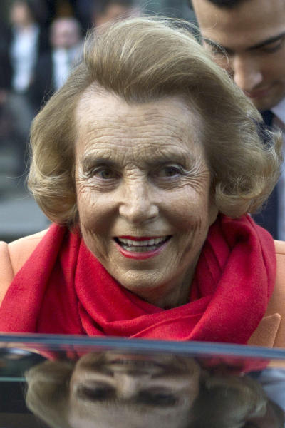 FILE - In this March 29, 2012 file photo, L'Oreal heiress Liliane Bettencourt leaves the L'Oreal-UNESCO prize for the women in science, in Paris. Former French President Nicolas Sarkozy went before a judge on Thursday, Nov.22, 2012 to respond to suspicions he illegally accepted donations from France's richest woman to fund his 2007 election campaign. The judge in Bordeaux could decide whether the 57-year-old conservative, a polarizing figure who often faced criticism for cozy ties to the rich, will be charged with taking advantage of the 90-year-old L'Oreal heiress, Liliane Bettencourt. Sarkozy has consistently denied all allegations. (AP Photo/Thibault Camus, File)