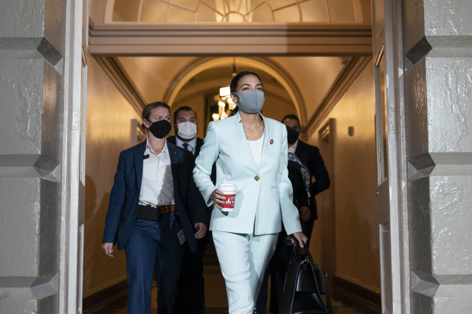 FILE - In this Oct. 1, 2021, file photo Rep. Alexandria Ocasio-Cortez, D-N.Y., arrives for a House Democratic Caucus meeting with President Joe Biden, on Capitol Hill, in Washington. (AP Photo/Alex Brandon, File)