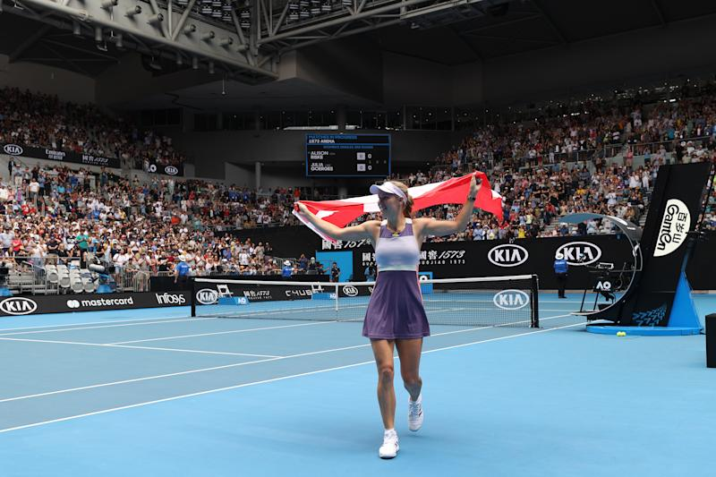 MELBOURNE, AUSTRALIA - JANUARY 24: Caroline Wozniacki of Denmark drapes a Danish flag over her shoulders and acknowledges the crowd after losing her Women's Singles third round match against Ons Jabeur of Tunisia on day five of the 2020 Australian Open at Melbourne Park on January 24, 2020 in Melbourne, Australia. (Photo by Clive Brunskill/Getty Images)