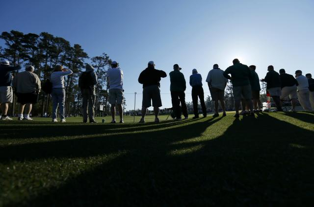 Patrons line the course during the first round of the Masters golf tournament at the Augusta National Golf Club in Augusta, Georgia April 10, 2014. REUTERS/Mike Blake (UNITED STATES - Tags: SPORT GOLF)