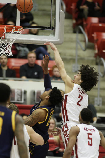 California forward Andre Kelly, left, shoots in front of Washington State forward CJ Elleby during the second half of an NCAA college basketball game in Pullman, Wash., Wednesday, Feb. 19, 2020. California won 66-57. (AP Photo/Young Kwak)