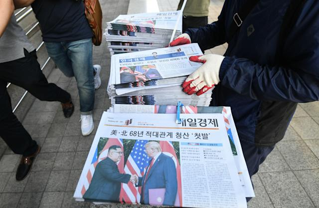 <p>A South Korean newspaper deliveryman collects newspapers in Seoul reporting the summit between President Donald Trump and North Korean leader Kim Jong Un on June 12, 2018. (Photo: Jung Yeon-je/AFP/Getty Images) </p>