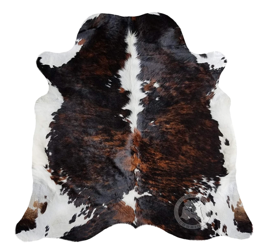 Sunshine Cowhides Brindle Dark Tricolor Cowhide Rug (Photo via Amazon)