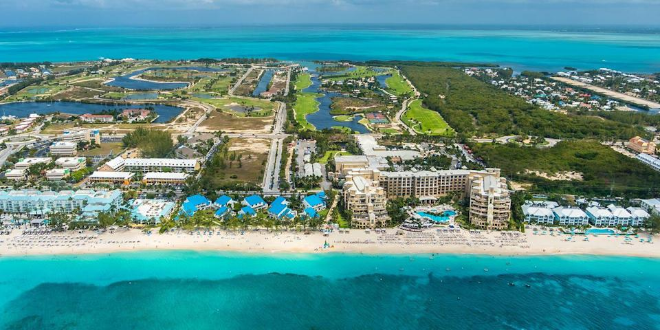 """<p>While the Caymans might be known as an offshore banking haven, it's definitely not <em>all</em> work and no play on this Caribbean isle. Kick back on dreamy beaches like <a rel=""""nofollow noopener"""" href=""""https://www.bestproducts.com/lifestyle/g2209/best-beaches-for-vacations/"""" target=""""_blank"""" data-ylk=""""slk:Seven Mile"""" class=""""link rapid-noclick-resp"""">Seven Mile</a>, one of the Caribbean's sweetest strands, <a rel=""""nofollow noopener"""" href=""""https://www.tripadvisor.com/Attraction_Review-g147365-d2198364-Reviews-Stingray_City-Grand_Cayman_Cayman_Islands.html"""" target=""""_blank"""" data-ylk=""""slk:swim with stingrays"""" class=""""link rapid-noclick-resp"""">swim with stingrays</a>, dive to shipwrecks, sip rum punches, well, just about everywhere, and stay in beachfront hotspots like the recently renovated <a rel=""""nofollow noopener"""" href=""""https://www.hotels.com/ho118800/"""" target=""""_blank"""" data-ylk=""""slk:Westin Grand Cayman"""" class=""""link rapid-noclick-resp"""">Westin Grand Cayman</a>. </p>"""