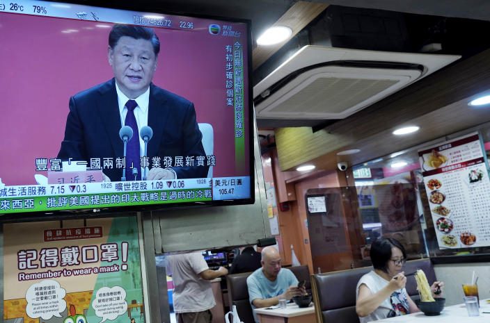 A TV screens broadcasts Chinese President Xi Jinping during an event to commemorate the 40th anniversary of the establishment of the Shenzhen Special Economic Zone in Shenzhen in southern China's Guangdogn Province at a restaurant in Hong Kong, Wednesday, Oct. 14, 2020. Xi promised Wednesday new steps to back development of China's biggest tech center, Shenzhen, amid a feud with Washington that has disrupted access to U.S. technology and is fueling ambitions to create Chinese providers. (AP Photo/Vincent Yu)
