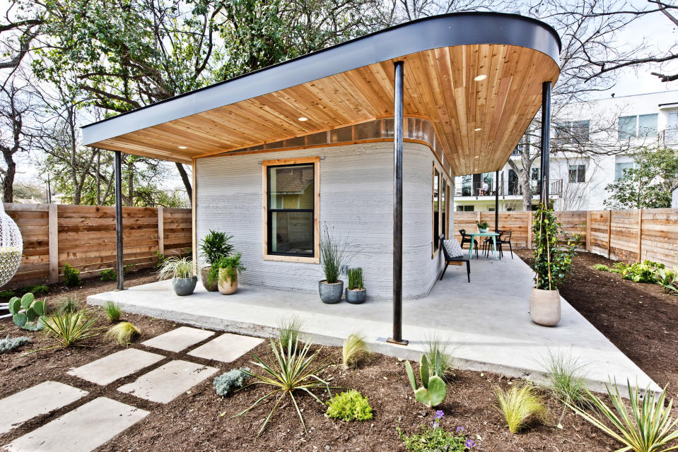 This photo provided by ICON shows a 3D home in Austin, Texas. A new generation of startups wants to disrupt the way houses are built by automating production with industrial 3D printers. (Regan Morton Photography/Courtesy of ICON via AP)