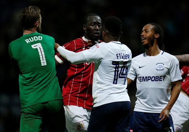 "Soccer Football - Championship - Preston North End vs Bristol City - Deepdale, Preston, Britain - March 6, 2018 Preston North End's Darnell Fisher clashes with Bristol City's Famara Diedhiou during the game Action Images/Ed Sykes EDITORIAL USE ONLY. No use with unauthorized audio, video, data, fixture lists, club/league logos or ""live"" services. Online in-match use limited to 75 images, no video emulation. No use in betting, games or single club/league/player publications. Please contact your account representative for further details."