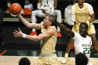 Georgia Tech guard Jordan Usher goes to the basket as Miami forward Deng Gak (22) defends during the first half of an NCAA college basketball game, Saturday, Feb. 20, 2021, in Coral Gables, Fla. (AP Photo/Lynne Sladky)