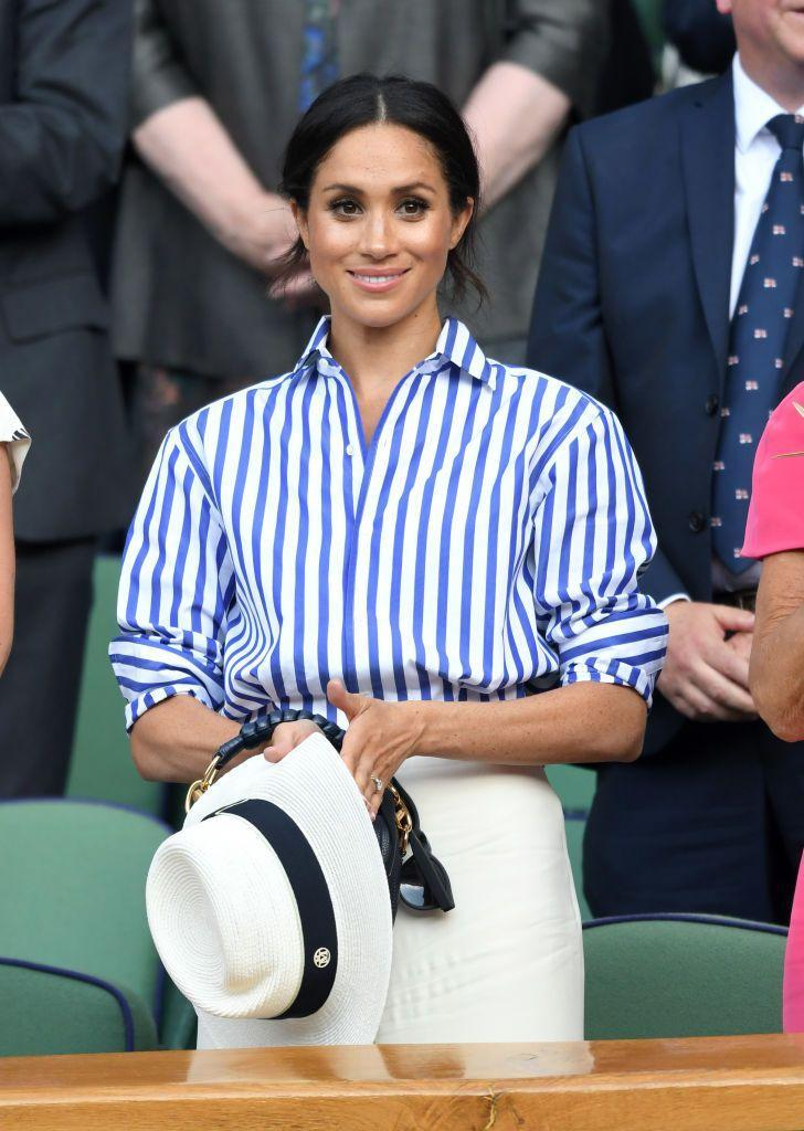 <p>The Duchess of Sussex wore a striped shirt with cream palazzo trousers.</p>