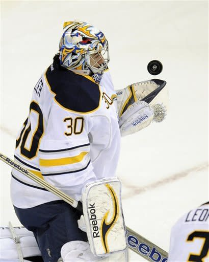Buffalo Sabres goalie Ryan Miller (30) keeps his eye on the puck during the first period of an NHL hockey game against the Washington Capitals, Tuesday, March 27, 2012, in Washington. (AP Photo/Nick Wass)