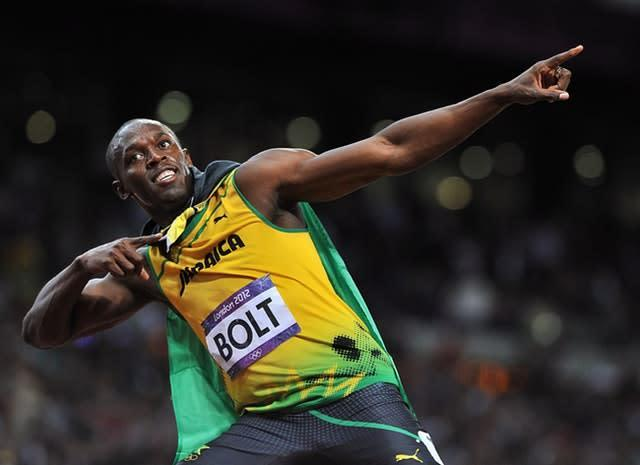 Usain Bolt celebrates after defending his men's 100m title in stunning style at London 2012, winning the final in an Olympic record time of 9.63 seconds. Seven of the eight finalists ran under 10 seconds in what was the fastest Olympic 100m final, with Jamaican Bolt clocking the second quickest time in history in front of an 80,000 capacity crowd (Martin Rickett/PA)