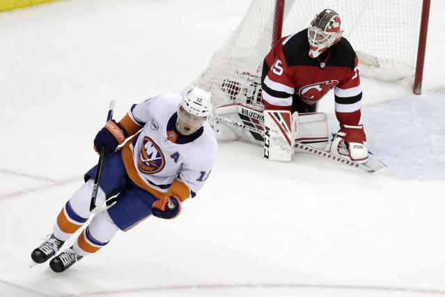 New York Islanders right wing Josh Bailey (12) reacts after scoring against New Jersey Devils goaltender Cory Schneider (35) during the shootout in an NHL hockey game Thursday, Feb. 7, 2019, in Newark, N.J. The Islanders won 2-1. (AP Photo/Julio Cortez)