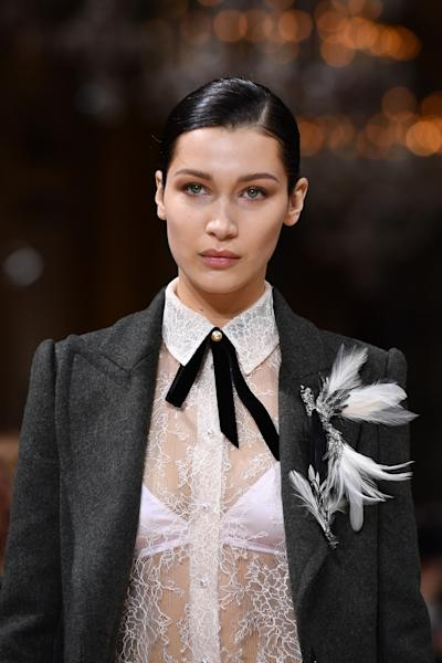 Bella Hadid stepped out with corkscrew curls instead of her usual straight hair—and it struck a chord with the Internet.