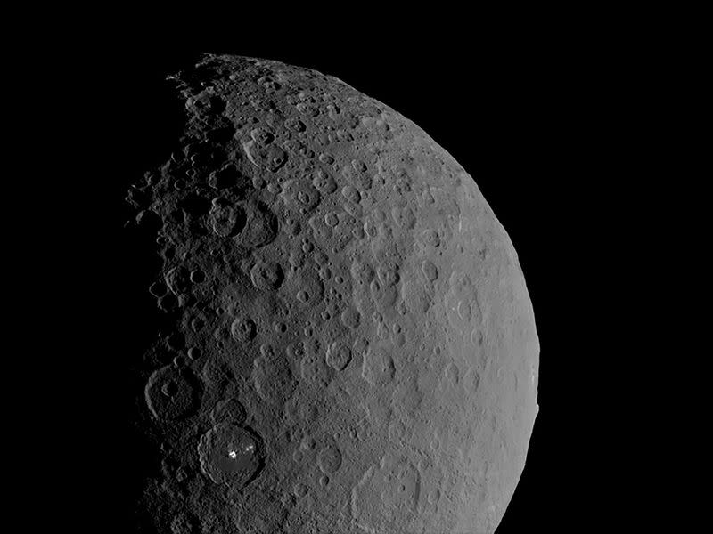 Occator Crater and Ahuna Mons appear together in this view of the dwarf planet Ceres