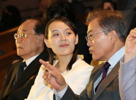 South Korean President Moon Jae-in talks with Kim Yo Jong, the sister of North Korea's leader Kim Jong Un, while watching North Korea's Samjiyon Orchestra's performance in Seoul, South Korea, February 11, 2018. Yonhap via REUTERS
