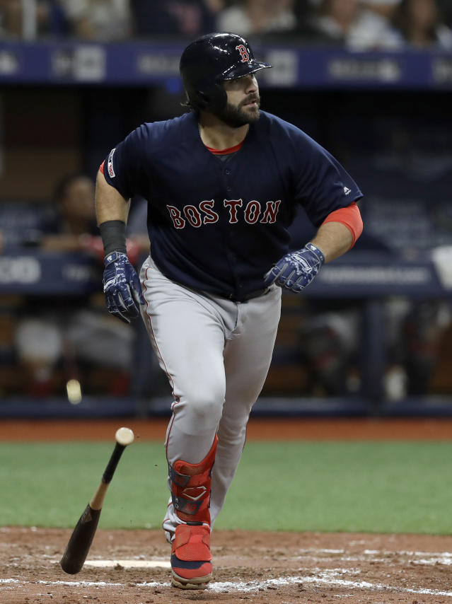 Boston Red Sox's Mitch Moreland watches his home run off Tampa Bay Rays relief pitcher Diego Castillo during the eighth inning of a baseball game Friday, April 19, 2019, in St. Petersburg, Fla. (AP Photo/Chris O'Meara)