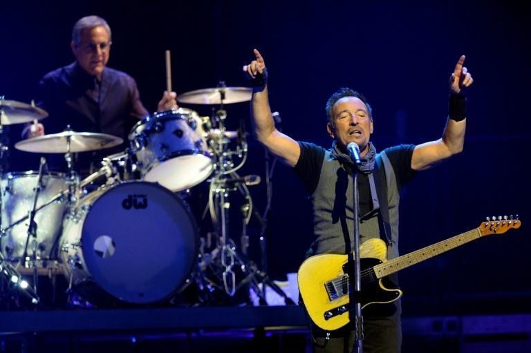 Bruce Springsteen, shown here performing with The E Street Band in 2016, says it's unlikely the band will be able to tour before 2022 due to coronavirus
