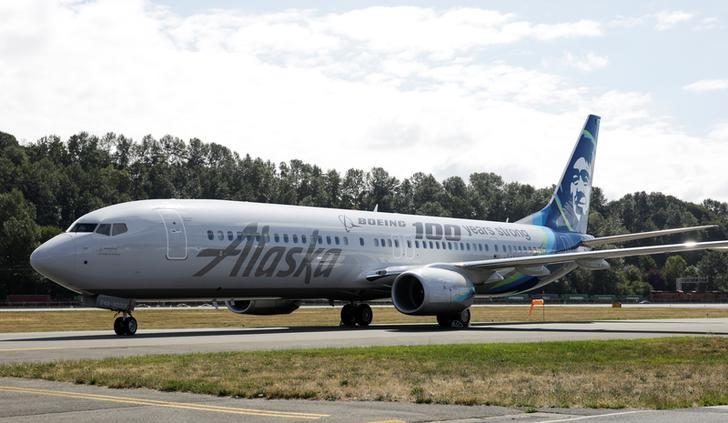 An Alaska Airlines plane is pictured with a paint job to mark the centennial of The Boeing Company in Seattle, Washington