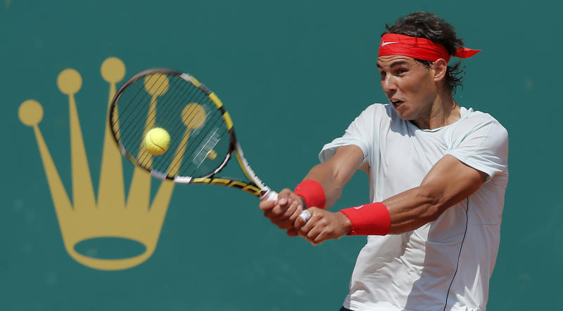 Spain's Rafael Nadal plays a return to Philipp Kohlschreiber of Germany during their match of the Monte Carlo Tennis Masters tournament in Monaco, Thursday, April 18, 2013. (AP Photo/Lionel Cironneau)