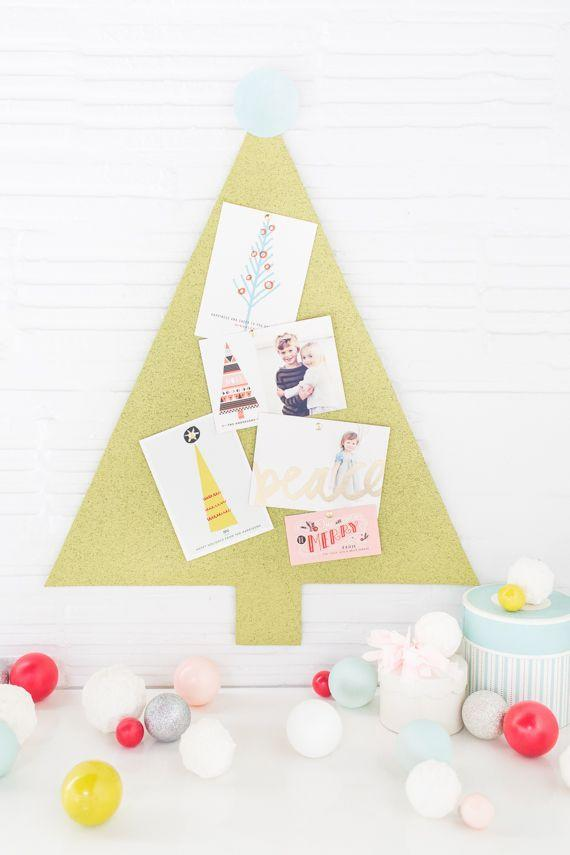 """<p>Bring your Pinterest addiction back to where it all began—an actual pin board.</p><p>Get the tutorial at <a href=""""https://go.redirectingat.com?id=74968X1596630&url=https%3A%2F%2Fwww.minted.com%2Fjulep%2F2014%2F12%2F15%2Fhow-to-display-your-holiday-cards-christmas-tree-pinboard%2F&sref=https%3A%2F%2Fwww.housebeautiful.com%2Fentertaining%2Fholidays-celebrations%2Fg22691991%2Fdiy-christmas-card-holders%2F"""" rel=""""nofollow noopener"""" target=""""_blank"""" data-ylk=""""slk:Ashley Rose"""" class=""""link rapid-noclick-resp"""">Ashley Rose</a>.</p>"""