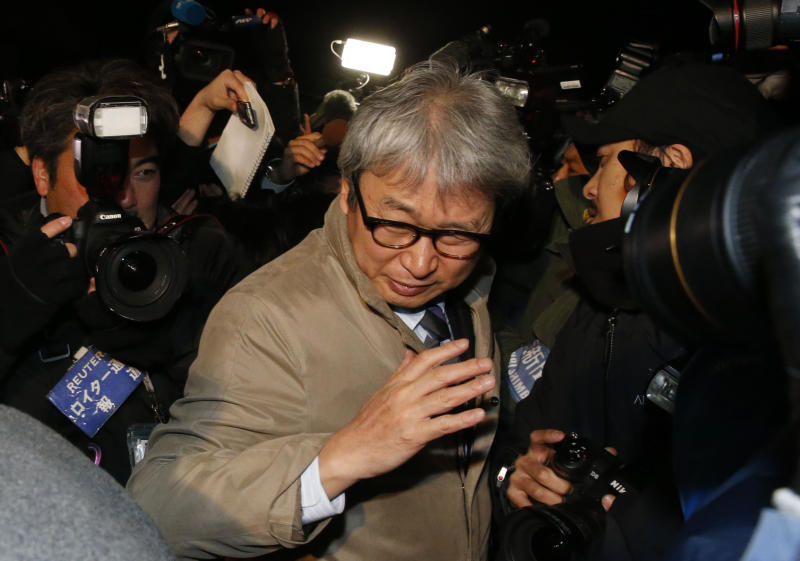 Motonari Otsuru, center, defense lawyer of former Nissan chairman Carlos Ghosn, is surrounded by journalists as he leaves the Tokyo Detention Center where Ghosn and another former executive Greg Kelly are being detained, in Tokyo, Thursday, Dec. 20, 2018. The Tokyo District Court on Thursday rejected the request for another 10-day detention over Ghosn's indictment for falsification of financial reports. (AP Photo/Shuji Kajiyama)