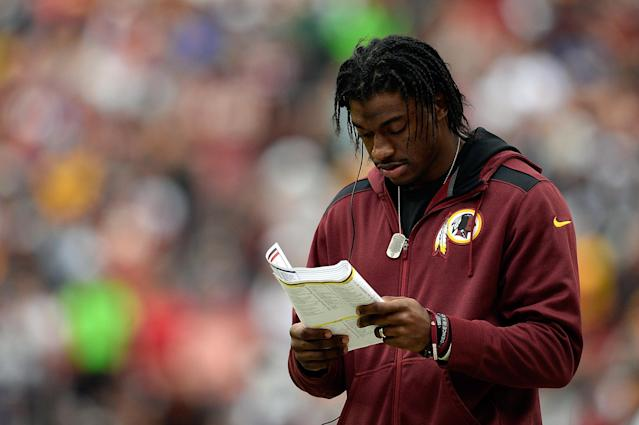 LANDOVER, MD - DECEMBER 22: Quarterback Robert Griffin III #10 of the Washington Redskins watches play from the sideline in the second quarter during an NFL game against the Dallas Cowboys at FedExField on December 22, 2013 in Landover, Maryland. (Photo by Patrick McDermott/Getty Images)