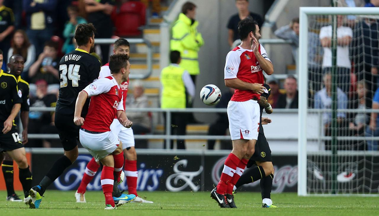 Rotherham's Lee Frecklington (centre red) scoring during the Capital One Cup, First Round match at the New York Stadium, Rotherham.
