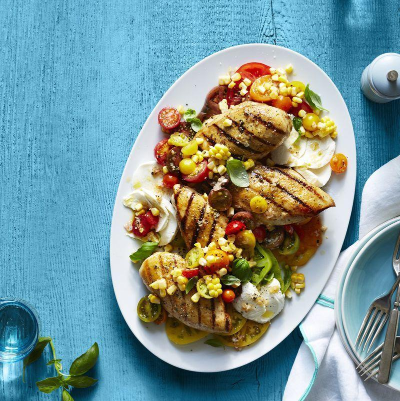 """<p>Adding chicken is a great way to turn a Caprese salad into a full-blown meal. Bonus! This recipe is heart healthy and takes 20 minutes total to make.</p><p><u><em><a href=""""https://www.womansday.com/food-recipes/food-drinks/recipes/a51545/grilled-chicken-caprese/"""" rel=""""nofollow noopener"""" target=""""_blank"""" data-ylk=""""slk:Get the recipe for Grilled Chicken Caprese."""" class=""""link rapid-noclick-resp"""">Get the recipe for Grilled Chicken Caprese.</a></em></u></p>"""